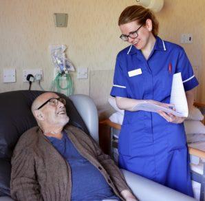 inpatient unit nurse with patient