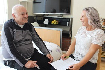 Community nurse with patient in his home