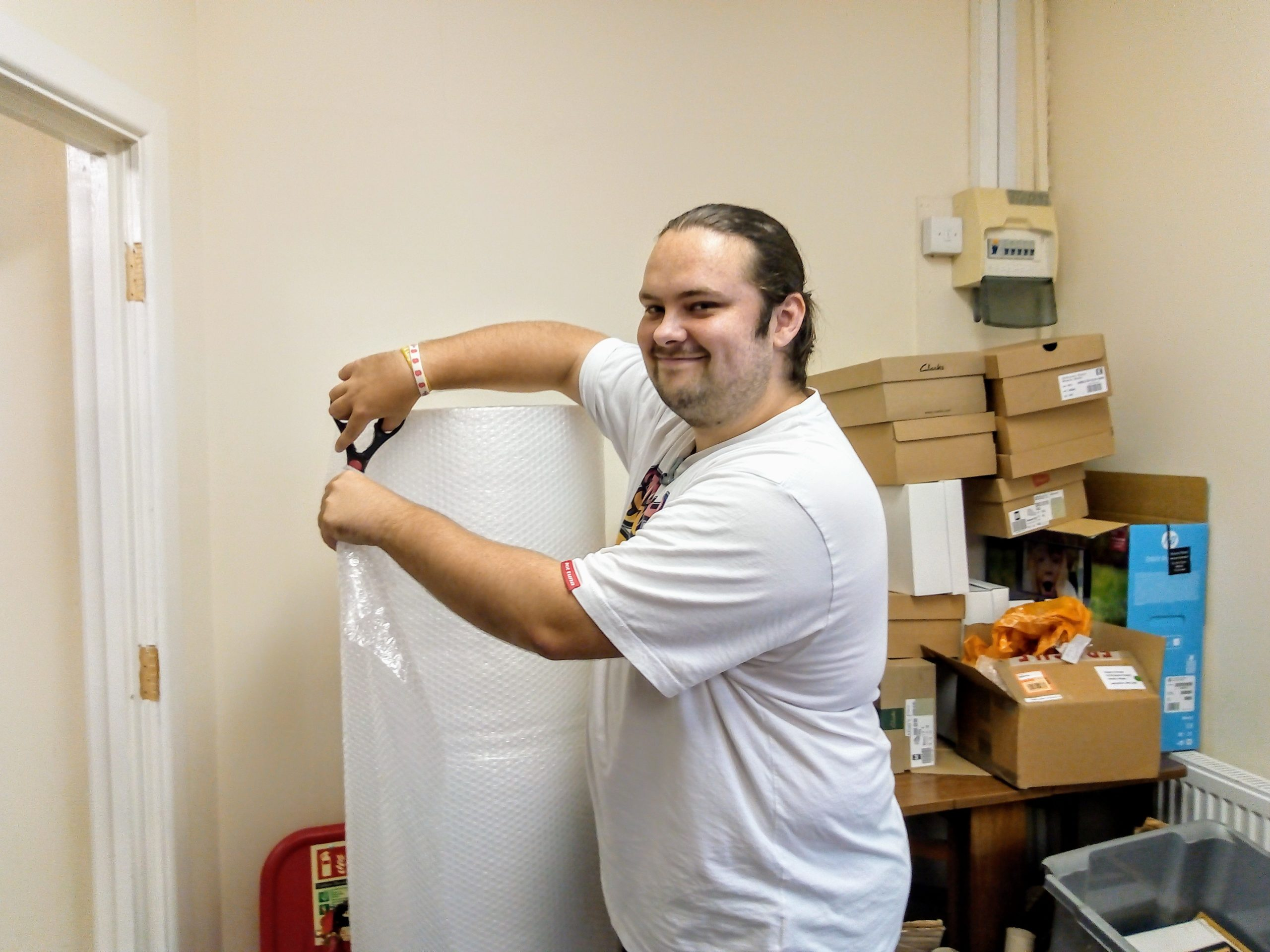 Man working with bubble wrap
